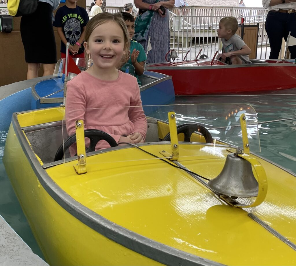 Granddaughter Annie loves the boat ride at Funland