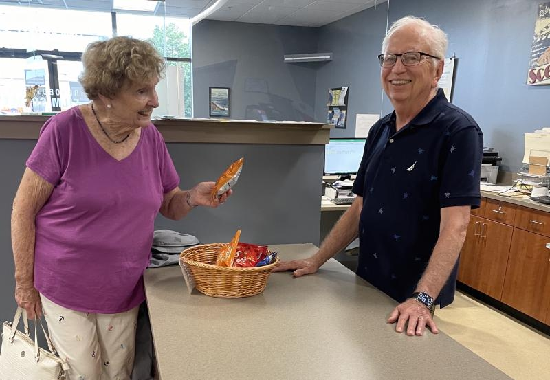 Volunteer Tony Paida from Lewes sells refreshments to longtime filmgoer Peg O'Connell of Bethany Beach.
